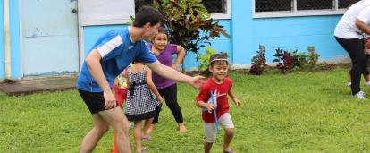 Projects Abroad volunteer teaches children rugby exercises on the Samoa Sports Coaching Project
